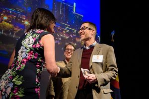 8z Real Estate COO Stefan Peterson accepting the Top Workplaces award on April 4th